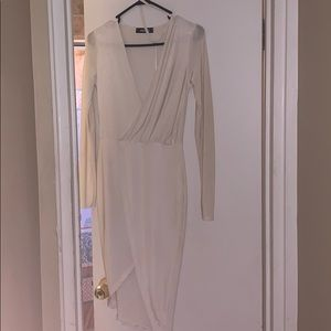 White fitted dress, stain on the back of right arm
